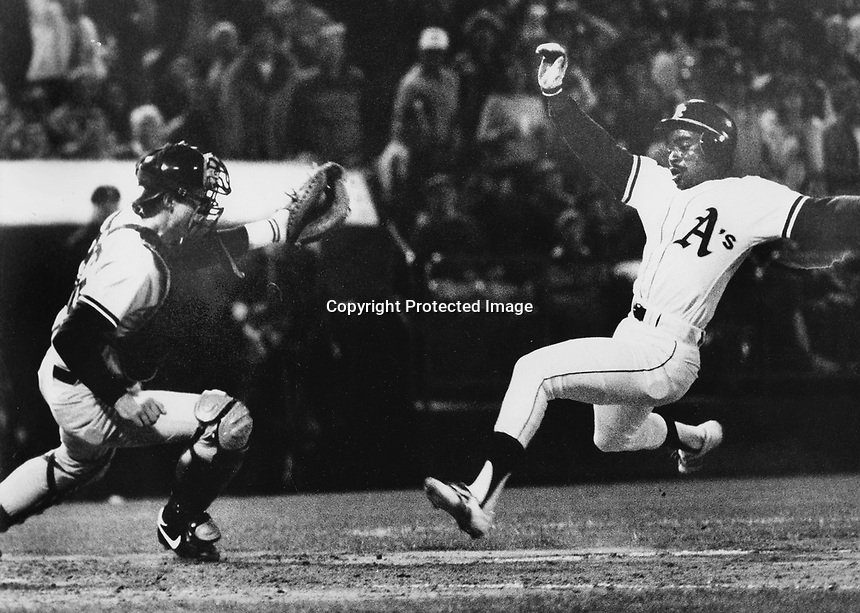 A's Tony Phillips scores. (1982 photo by Ron Riesterer)
