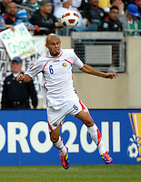 Costa Rica's Heiner Mora heads the ball.  Mexico defeated Costa Rica 4-1 at the 2011 CONCACAF Gold Cup at Soldier Field in Chicago, IL on June 12, 2011.