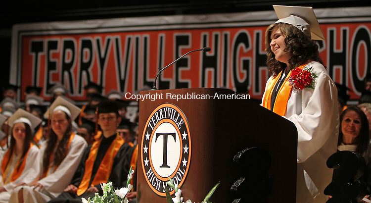 Terryville, CT-061814MK07 Kayley Siemiatoski, valedictorian, of the Terryville High School's class 2014 addresses her classmates during commencement exercises on Wednesday evening at Terryville High School.  One-hundred and nineteen graduates received diplomas. Michael Kabelka / Republican-American
