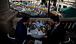 HALLANDALE BEACH, FL - JANUARY 27: Two spectators read the program and enjoy their meal while watching the paddock on Pegasus World Cup Invitational Day at Gulfstream Park Race Track on January 27, 2018 in Hallandale Beach, Florida. (Photo by Scott Serio/Eclipse Sportswire/Getty Images)