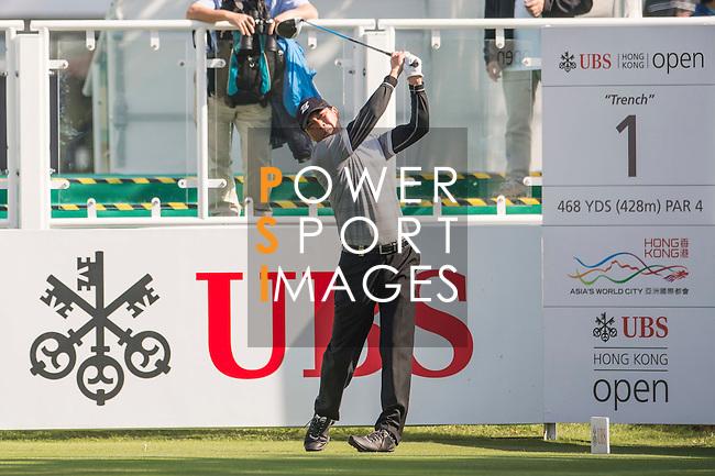 Zhang Lianwei of China tees off the first hole during the 58th UBS Hong Kong Open as part of the European Tour on 08 December 2016, at the Hong Kong Golf Club, Fanling, Hong Kong, China. Photo by Marcio Rodrigo Machado / Power Sport Images