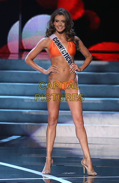 Erin Brady, Miss Connecticut USA<br />  2013 Miss USA Pageant Preliminary competition at PH Live inside Planet Hollywood Resort and Casino, Las Vegas, NV, USA, <br /> 12th June 2013.<br /> full length orange bikini sash hands on hips  <br /> CAP/ADM/MJT<br /> &copy; MJT/AdMedia/Capital Pictures