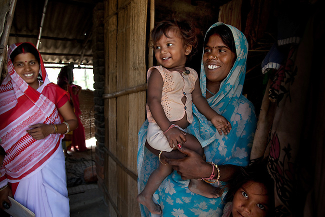 Bindu Devi with her son Sahil Kumar (right) and Anganwadi health worker Priya Kumari (left) at her home in Bhagwanpuri Raiti  village on their way to the local Anganwadi clinic where oral rehydration salts (ORS) and zinc tablets are given out to combat the sometimes fatal effects of diarrhea.The village located in Vaishali district outside Patna in Bihar, India has been rolling out the ORS and Zinc program as part of the IKEA Social Initiative to combat child mortality rates caused by diarrhea. It is proving to be very successful with education and support provided by local nursing staff, health activists  and program officers from UNICEF. The treatment is a 14 day course administering diluted oral rehydration salts and a zinc tablet which is more effective than salts alone in combating the effects of severe diarrhea. Picture by Graham Crouch/UNICEF