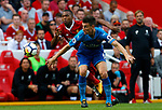 Liverpool's Daniel Sturridge (L) in action with Arsenal's Laurent Koscielny during the premier league match at Anfield Stadium, Liverpool. Picture date 27th August 2017. Picture credit should read: Paul Thomas/Sportimage