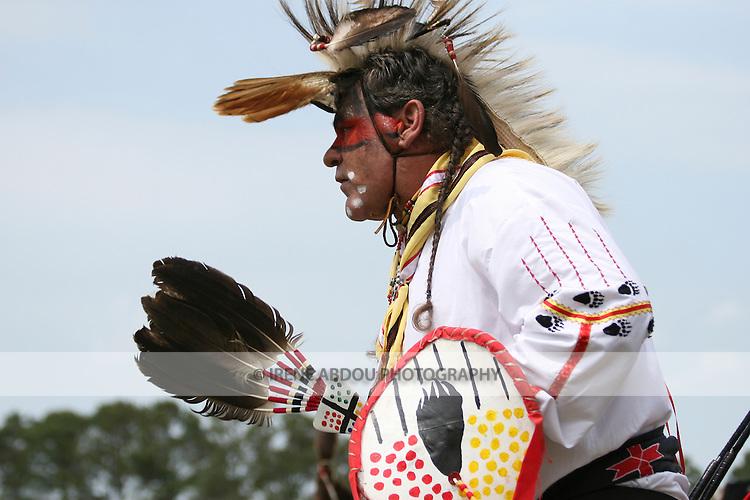 A Native American man dances in full traditional regalia at the 8th Annual Redwing PowWow in Virginia Beach, Virginia.