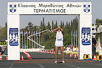 02 NOV 2003 -  ATHENS, GREECE - Nicos Polias (GRE) finishes the 21st Athens Classic Marathon. (PHOTO (C) NIGEL FARROW)