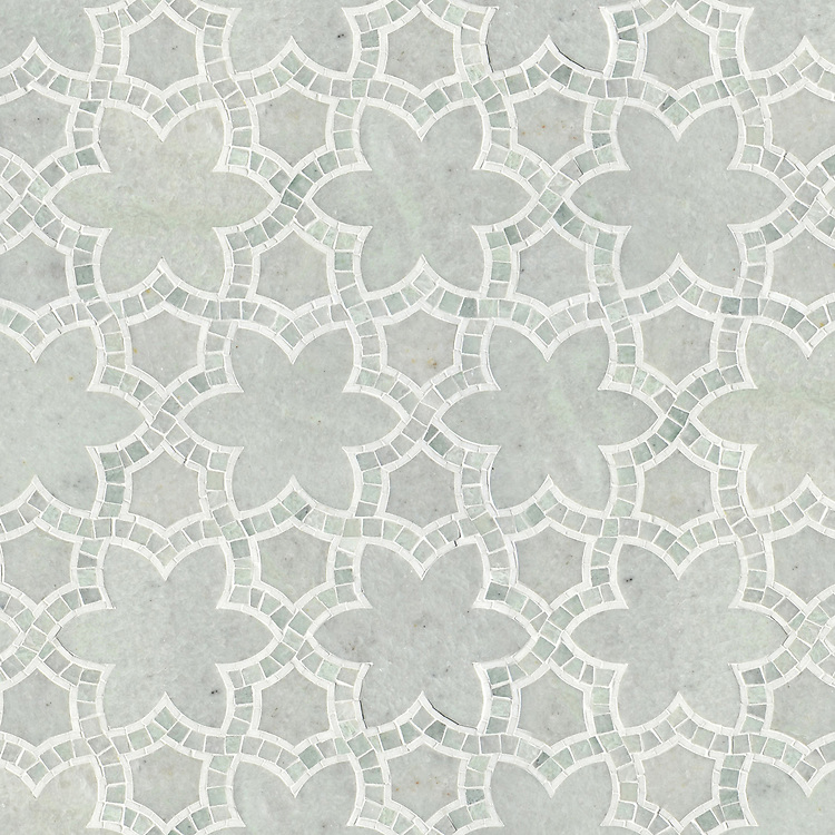 Reina, a waterjet and hand-cut stone mosaic, shown in Ming Green and Thassos polished, is part of the Miraflores Collection by Paul Schatz for New Ravenna Mosaics. As seen in Elle Decor.