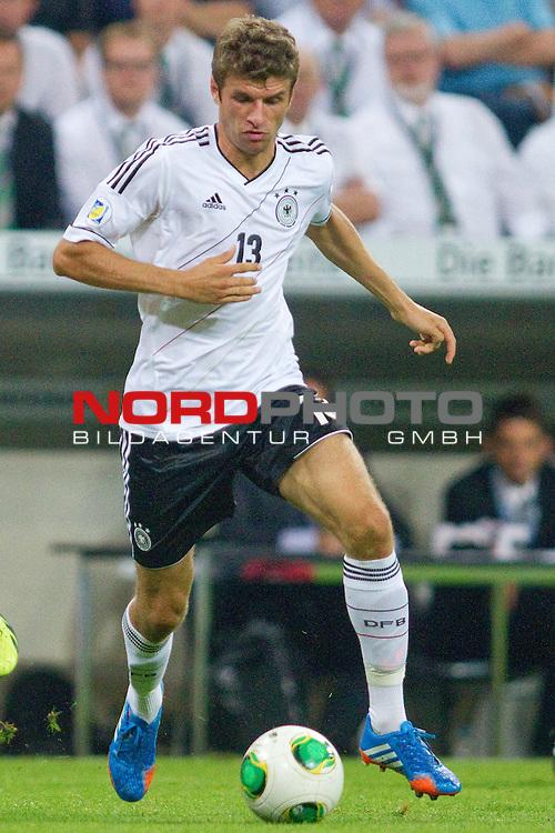 06.09.2013, Allianz Arena, Muenchen, GER, WM Quali,  Deutschland vs. Oesterreich , im Bild Thomas Mueller (GER FCB #13)  / Foto © nph / Straubmeier *** Local Caption ***