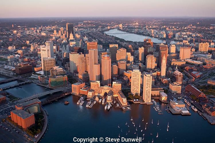 Boston skyline aerial sunrise view from harbor, Boston, MA