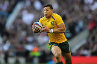 Israel Folau of Australia sets up a try for Matt Toomua of Australia during the QBE Autumn International match for the Cook Cup between England and Australia at Twickenham on Saturday 2nd November 2013 (Photo by Rob Munro)