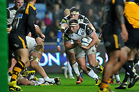 Henry Thomas of Bath Rugby takes on the Wasps defence. European Rugby Champions Cup match, between Wasps and Bath Rugby on December 13, 2015 at the Ricoh Arena in Coventry, England. Photo by: Patrick Khachfe / Onside Images