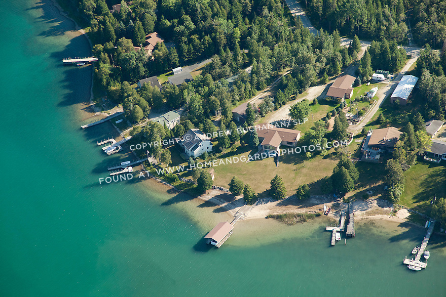 homes and boathouses on Hill Island shoreline, Les Cheneaux area of Lake Huron near Cedarville, MI