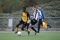 VOETBAL: GROU: Sportpark Meinga, 04-11-2012, GAVC - St. Annaparochie, Zondag 2e Klasse K, Einduitslag 1-1, Magiel Nsilu (#11 | GAVC), Dirk Jan Keizer (#5 | St.Anna), ©foto Martin de Jong