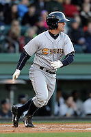 First baseman Mike Ford (26) of the Charleston RiverDogs runs out a ground ball in a game against the Greenville Drive on Wednesday, April 16, 2014, at Fluor Field at the West End in Greenville, South Carolina. Charleston won, 8-7. (Tom Priddy/Four Seam Images)