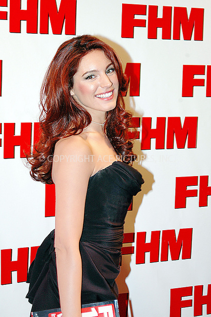 WWW.ACEPIXS.COM . . . . .  ... . . . . US SALES ONLY . . . . .....LONDON, APRIL 21, 2005....Kelly Brook at the FHM 100 Sexiest Women Party 2005 held at Umbaba.....Please byline: FAMOUS-ACE PICTURES-T. ALBAN... . . . .  ....Ace Pictures, Inc:  ..Craig Ashby (212) 243-8787..e-mail: picturedesk@acepixs.com..web: http://www.acepixs.com