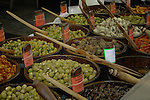 Selection of assorted mushroom and olive dishes with different recipes for sale on delicatessen stall in food market. Viktualienmarkt, Munich, Germany.