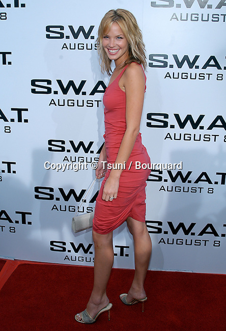 "Ashley Scott arriving at the "" S.W.A.T. Premiere "" at the Westwood Village Theatre in Los Angeles. July 30, 2003."