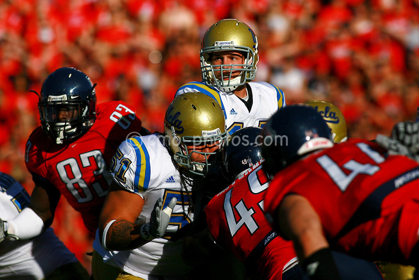 Oct 24, 2009; Tucson, AZ, USA; UCLA Bruins quarterback Kevin Prince (14) stands in a crowded pocket in the 1st quarter of a game against the Arizona Wildcats at Arizona Stadium.  The Wildcats defeated the Bruins 27-13.