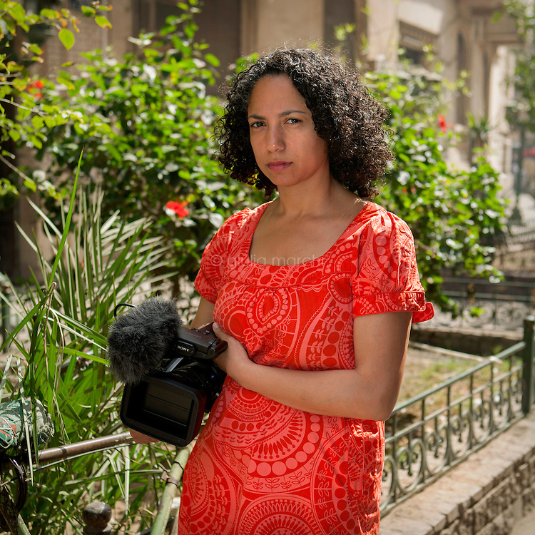 """Egypt / Cairo / 3.4.2013 / Amal Ramsis, Egyptian documentary film maker, poses with her camera in Downtown Cairo. She has explored all that is forbidden in Egypt in her documentary film """"Forbidden"""". © Giulia Marchi"""