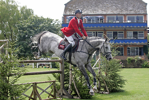 27 July 2006: German rider Rene Tebbel (GER) rides TEAM HARMONY COUPE DE COUER in The Royal International Chase during the second day of The Longines Royal International Horse Show, Hickstead England. Photo: Glyn Kirk/Actionplus....060727 man men male showjump showjumping .