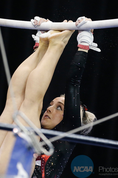 Apr 18, 2015; Fort Worth, TX, USA;  Taylor Rice from Stanford University performs the uneven parallel bars during the Division I Women's Gymnastics Championship held at the Fort Worth Convention Center Arena in Fort Worth, Texas. Tim Heitman/NCAA Photos