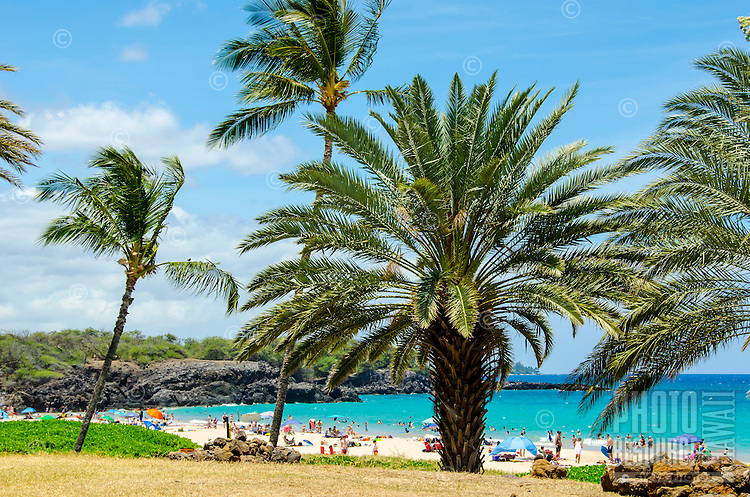Crowd of beachgoers at Hapuna Beach, along the Big Island's Kohala Coast. This white sand beach has been rated one of the best beaches in the world time and time again.
