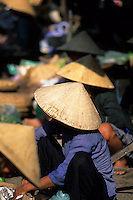 Coolie Hat line-up at market in Hoi An, Vietnam