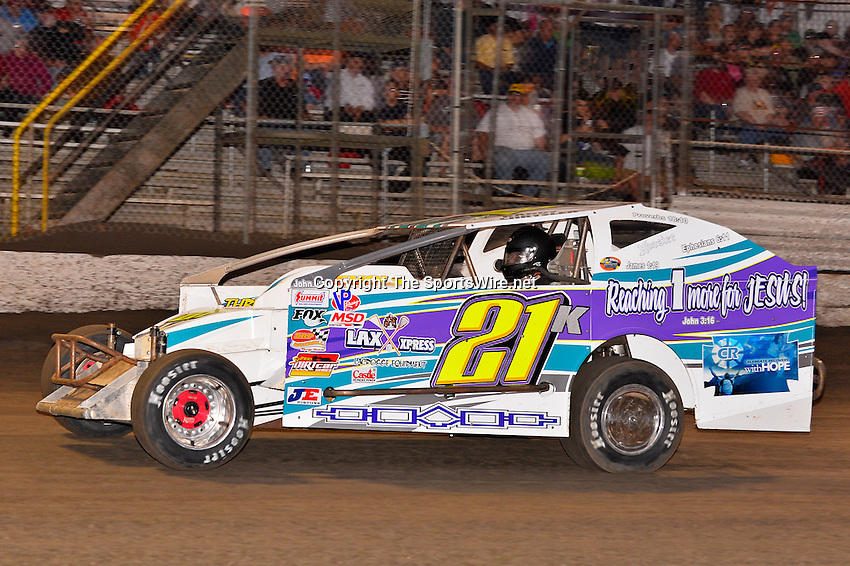 Feb 20, 2014; 6:24:52 PM;  Barberville, FL, USA;  Super DIRT car Series Big Block Modifieds presented by Summit Racing Equipment at Volusia Speedway Park.  Mandatory Credit: (thesportswire.net)