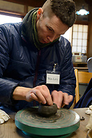 Visitors try their hand at making Bizen pottery. Bizen city, Okayama Pref, Japan, January 29, 2014. The city of Bizen in central Japan is famous for Bizen-ware pottery. It is also one of Japan's main traditional sword making regions, home to Osafune sword-makers and polishers.