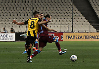 Trabzonspor's Abdülkadir Parmak (R) in action against AEK's Andre Simoes (L) during of the UEFA Europa League play-off, 1st leg, soccer match between AEK Athens FC and Trabzonspor at the OAKA Spyros Louis Stadium in Athens, Greece on August 22, 2019.