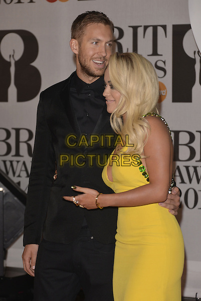 LONDON, ENGLAND - FEBRUARY 19: Calvin Harris &amp; Rita Ora attends The BRIT Awards 2014 at 02 Arena on February 19, 2014 in London, England.<br /> CAP/PL<br /> &copy;Phil Loftus/Capital Pictures
