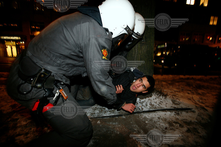Protester is caught by riot police. Pro-Palestinian protesters clashed with police as they held a counter demonstration against pro-Israel campaigners in the Norwegian capital Oslo. Violent clashes lasted for hours  in the centre of Oslo. Both groups came to the streets as a result of the violence in Gaza. Israeli forces began a series of air strikes on the Gaza Strip on the 27th of December in retaliation against Hamas rockets fired into Israel. After eight days of bombardment, leaving over 400 Palestinians and four Israelis dead, Israeli tanks launched a ground invasion on the 4th of January.
