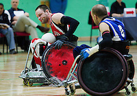 15 AUG 2011 - LEEDS, GBR - Canada's Fabien Lavoie (left) attempts to avoid a challenge from Great Britain's Jonny Coggan (right) during the wheelchair rugby exhibition match between the two teams (PHOTO (C) NIGEL FARROW)