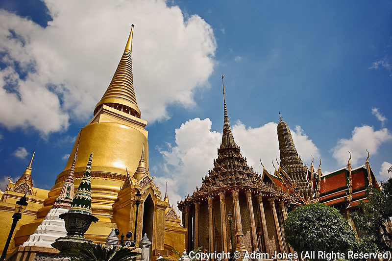Upward view of The Phra Si Rattana Chedi, The Phra Mondrop, and The Royal Pantheon, Wat Phra Kaeo, Bangkok, Thailand