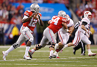 Ohio State Buckeyes quarterback Cardale Jones (12) looks for an open receiver before running for a first down in the third quarter of the Big Ten Championship game between the Ohio State Buckeyes and the Wisconsin Badgers at Lucas Oil Stadium in Indianapolis, Saturday night, December 6, 2014. As of half time the Ohio State Buckeyes led the Wisconsin Badgers 38 - 0. (The Columbus Dispatch / Eamon Queeney)