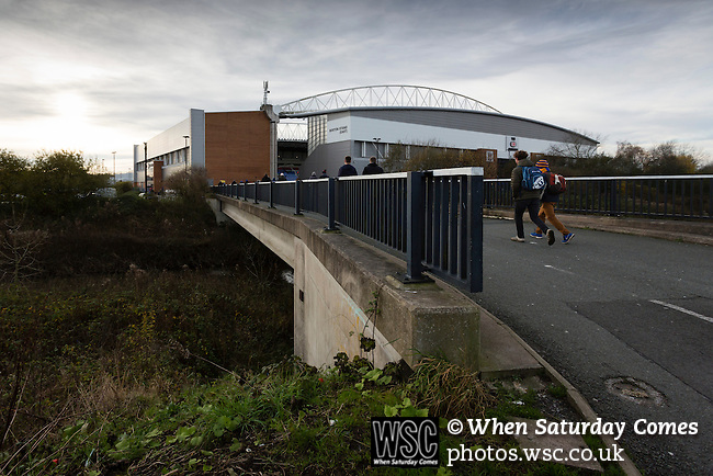 Wigan Athletic 1 Shrewsbury Town 0, 21/11/2015. DW Stadium, League One. The DW Stadium. Wigan Athletic earned a narrow 1-0 at home to Shrewsbury Town. Wigan competed in the Premier League from 2005 to 2013. They won the 2013 FA Cup. The club also embarked on its first European campaign during the 2013–14 UEFA Europa League. Fans walking to The DW Stadium. Photo by Paul Thompson