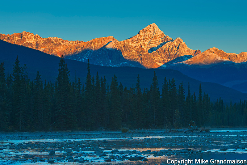 Sunrise on the Canadian Rocky Mountains with the Athabasca River. Icefields Parkway.<br />Jasper National Park<br />Alberta<br />Canada