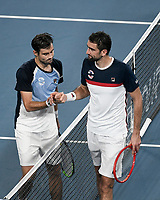 8th January 2020; Sydney Olympic Park Tennis Centre, Sydney, New South Wales, Australia; ATP Cup Australia, Sydney, Day 6; Croatia versus Argentina; Marin Cilic of Croatia versus Guido Pella of Argentina; Guido Pella of Argentina and Marin Cilic of Croatia shake hands after their match which Pella won - Editorial Use
