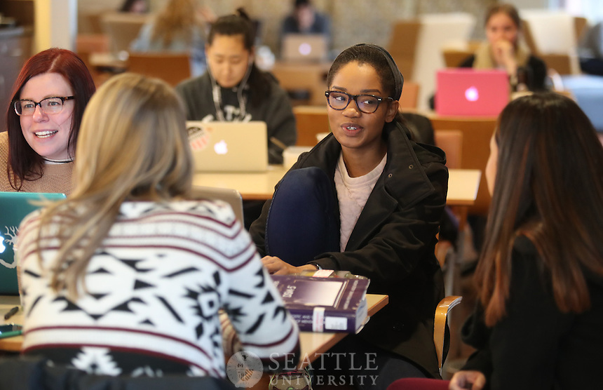 December 1st 2016- Graduate students Veronica Griffin, center, & Hope Ewing, left, in the COE School Psychology program hit the books during a group study for finals in the Library at Seattle University.