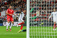 Andrew Hogg of Malta saves a shot from Theo Walcott (Arsenal) of England (2nd left) during the FIFA World Cup qualifying match between England and Malta at Wembley Stadium, London, England on 8 October 2016. Photo by David Horn / PRiME Media Images.