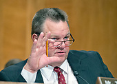 """United States Senator Jon Tester (Democrat of Montana) questions Timothy J. Sloan, Chief Executive Officer and President, Wells Fargo & Company, as he testifies before the US Senate Committee on Banking, Housing, and Urban Affairs as they conduct a hearing entitled, """"Wells Fargo: One Year Later"""" on Capitol Hill in Washington, DC on Tuesday, October 3, 2017. <br /> Credit: Ron Sachs / CNP"""