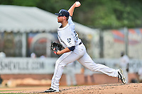 Asheville Tourists starting pitcher Ryan McCormick (28) delivers a pitch during game one of a double header against the Charleston RiverDogs at McCormick Field on July 8, 2016 in Asheville, North Carolina. The RiverDogs defeated the Tourists 10-4 in game one. (Tony Farlow/Four Seam Images)