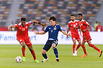 Ahmed Al Mahaijri of Oman (L) competes for the ball with Minamino Takumi of Japan (R) during the AFC Asian Cup UAE 2019 Group F match between Oman (OMA) and Japan (JPN) at Zayed Sports City Stadium on 13 January 2019 in Abu Dhabi, United Arab Emirates. Photo by Marcio Rodrigo Machado / Power Sport Images