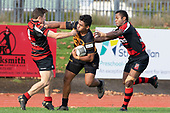 Taimua Malielegaoi tries to fend off Jamie Harford. Counties Manukau Premier Club Rugby game between Papakura and Bombay, played at Massey Park Papakura on Saturday June 16th 2018. Bombay won the game 36 - 17 after leading 17 - 7 at halftime.<br /> Papakura Ray White 17 - Kris Smithson 2, Taafaga Tagaloa tries, Monty Punatai conversion.<br /> Bombay 36 - Jordan Goldsmith, Haamiora Clarke 2, Patrick Masoe, Mitchell Thackham, Chay Mackwood tries, Jordan Goldsmith 2, Ki<br /> Anufe conversions.<br /> Photo by Richard Spranger.