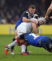 Schalk Brits is double-tackled. Aviva Premiership match, between Bath Rugby and Saracens on December 22, 2012 at the Recreation Ground in Bath, England. Photo by: Patrick Khachfe / Onside Images
