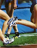 USA, California, low angle of women athletes racing on USC track, Los Angeles