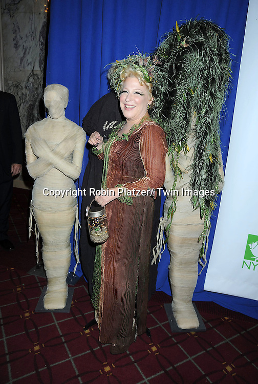 Bette Midler and zombies attending the 15th Annual  Hulaween Benefit Gala at the Waldorf Astoria Hotel in New York City on October 29, 2010..The gala benefits Bette Midler's New York Restoration Project.
