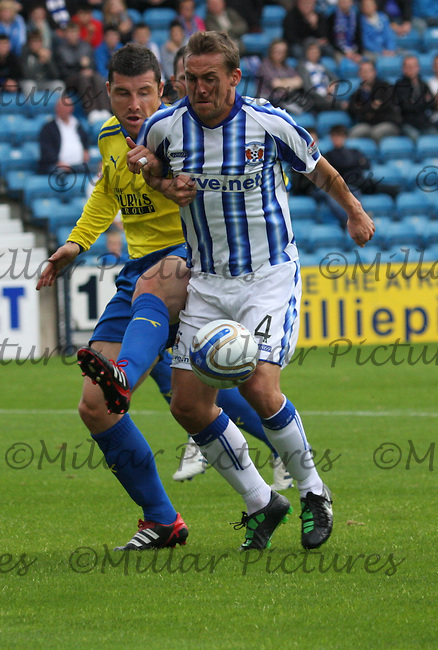 Austin McCann gets the better of James Fowler in the Kilmarnock v Dunfermline Athletic Clydesdale Bank Scottish Premier League match played at Rugby Park, Kilmarnock on 10.9.11.