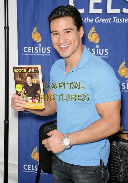 MARIO LOPEZ.Cosmopolitan magazine Hosts third annual Bikini Bash, presented by Nivea, at the Planet Hollywood Resort and Casino, Las Vegas, Nevada, USA..May 24th, 2010.half length blue top book extra lean .CAP/ADM/MJT.© MJT/AdMedia/Capital Pictures.