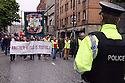 Police escort the trade union Anti G8 demonstration during protests against the G8 Summit in Belfast, Northern Ireland, 15 June 2013. Leaders from Canada, France, Germany, Italy, Japan, Russia, USA and UK are meeting at Lough Erne in Northern Ireland for the G8 Summit 17-18 June.